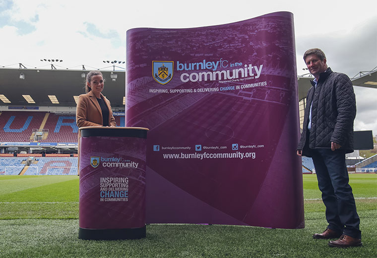 Pop up display stand football charity