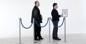 Men Waiting in Line